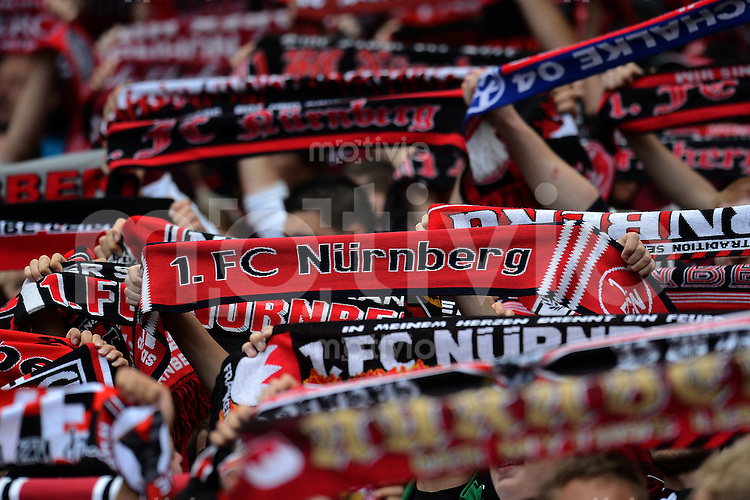 FUSSBALL   1. BUNDESLIGA  SAISON 2012/2013   2. Spieltag 1. FC Nuernberg - Borussia Dortmund       01.09.2012 1 FC Nuernberg Fans mit Schal