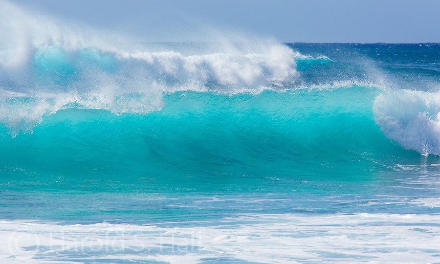 A beautiful aqua wave on the famous Sunset Beach on the North Shore of Oahu, Hawaii.