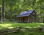 Log cabin with split rail fence in GSMNP.