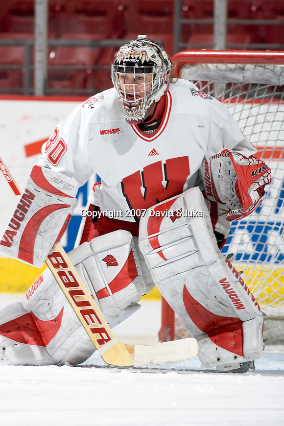 MADISON, WI - FEBRUARY 16: Goalie Jessie Vetter #30 of the Wisconsin Badgers women's hockey team warms up prior to the game against the Bemidji State Beavers at the Kohl Center on February 16, 2007 in Madison, Wisconsin. The Badgers beat the Beavers 2-0. (Photo by David Stluka)