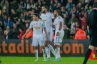 Sunday 9th November 2014<br /> Pictured: ( L-R )  Jefferson Montero of Swansea City Kyle Bartley of Swansea City and Ashley Williams after the game <br /> Re: Barclays Premier League Swansea City v Arsenal at the Liberty Stadium, Swansea, Wales,UK