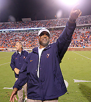Virginia head coach Mike London signals to the fans after the 19-16 win over Brigham Young in Charlottesville, Va. Photo/Andrew Shurtleff