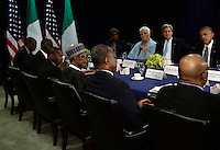 United States President Barack Obama (R) listens at a bilateral meeting with the The President of the Federal Republic of Nigeria  Muhammadu Buhari (left wearing hat) during the United Nations 71st session of the General Debate at the United Nations General Assembly at United Nations headquarters in New York, New York, USA, 27 September 2016. Photo Credit: Peter Foley/CNP/AdMedia