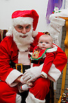 Baby Callum Clail visits Santa in his grotto at the Youthreach Party..Picture: Shane Maguire / www.newsfile.ie.
