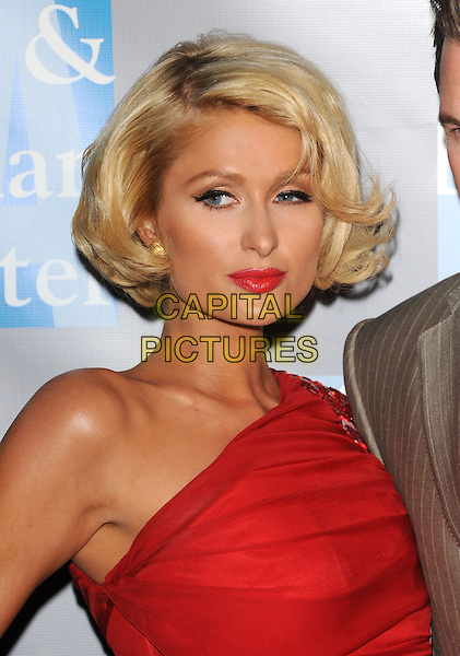 "PARIS HILTON .at ""An Evening With Women: Celebrating Art, Music & Equality"" held at The Beverly Hilton Hotel in Beverly Hills, California, USA, April 24th 2009.                                                                     .portrait headshot red one shoulder lipstick bob .CAP/DVS.©Debbie VanStory/RockinExposures/Capital Pictures"