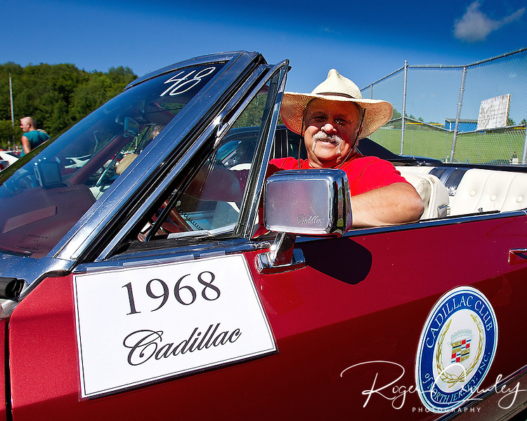 BARTON VT - 144th Orleans County Fair in the scenic Northeast Kingdom village of Barton, Vermont broke the Guinness World Records of the longest Cadillac Parade in history with 298 cars Wednesday in Barton Vermont. Bob Walton from New Jersey poises in his 1968 Eldorado Cadillac while waiting for the parade to begin. Walton has traveled over 7,292 miles to the Pacific coast and back including 2,448 miles on historic Route 66...