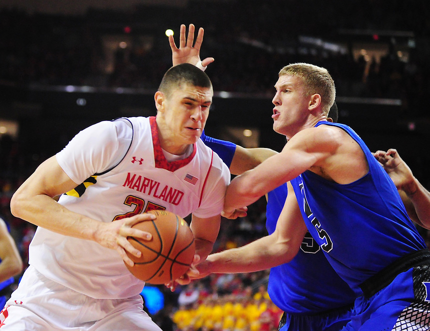 Alex Len of the Terrapins goes to the basket against Mason Plumlee of the Bluedevils. Maryland defeated Duke 81-83 at the Comcast Center in College Park, MD on Saturday, February 16, 2013. Alan P. Santos/DC Sports Box