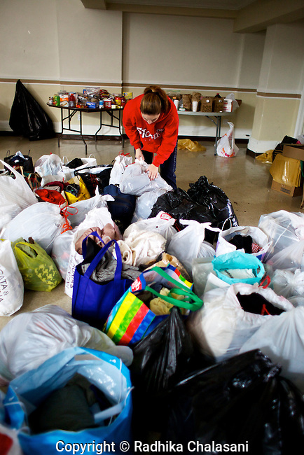 BELLE HARBOR, NEW YORK-NOVEMBER 01: Volunteers collect and distribute clothing donations at Francis de Sales Church to residents of this Rockaway, Queens neighborhood after Hurricane Sandy November 1, 2012. Residents have set up a Facebook page ,Rockaway Relief, to get assistance to their community.