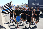 Carson City Sheriff&rsquo;s and other law enforcement representatives run the memorial baton into downtown Carson City, Nev., on Wednesday, May 3, 2017. The 20th annual Nevada Law Enforcement Memorial ceremony will be tomorrow.<br /> Photo by Cathleen Allison/Nevada Photo Source