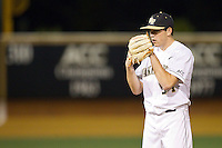 Wake Forest Demon Deacons relief pitcher Max Tishman (34) looks to his catcher for the sign against the High Point Panthers at Wake Forest Baseball Park on April 2, 2014 in Winston-Salem, North Carolina.  The Demon Deacons defeated the Panthers 10-6.  (Brian Westerholt/Four Seam Images)
