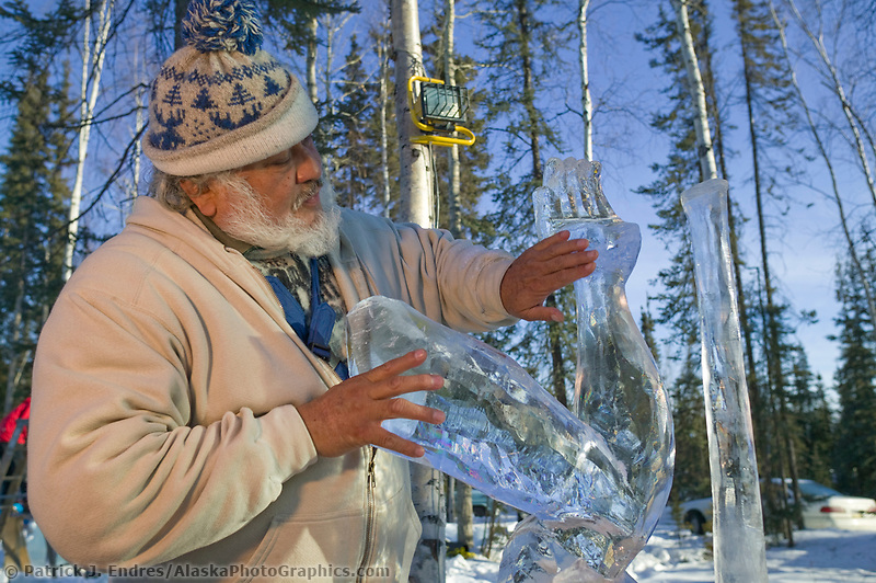 Abel Ramirez sculpts In your wildest dreams Multi Block, 2003 World Ice Art Championships, Fairbanks Alaska. Multi Block team Anita Tabor, Greg Barthalomew, Kathleen Carlo, Abel Ramirez,.