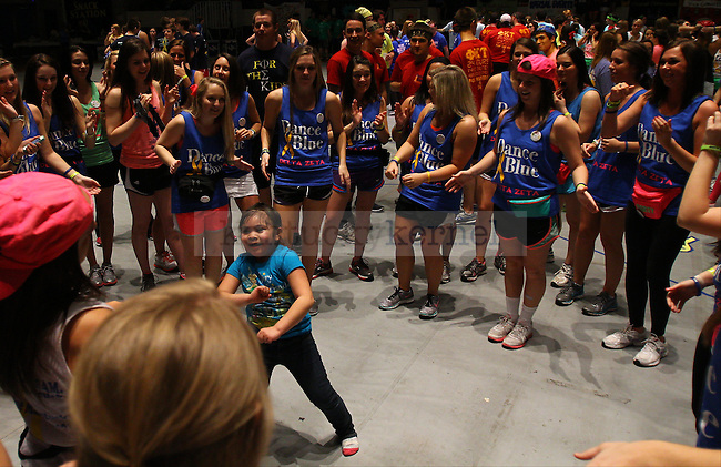 Yareli Gomez, age 6, dances with Delta Zeta sorority girls at DanceBlue 2013 at Memorial Coliseum in Lexington, Ky., on Friday, February 22, 2013. Photo by Michael Reaves | Staff