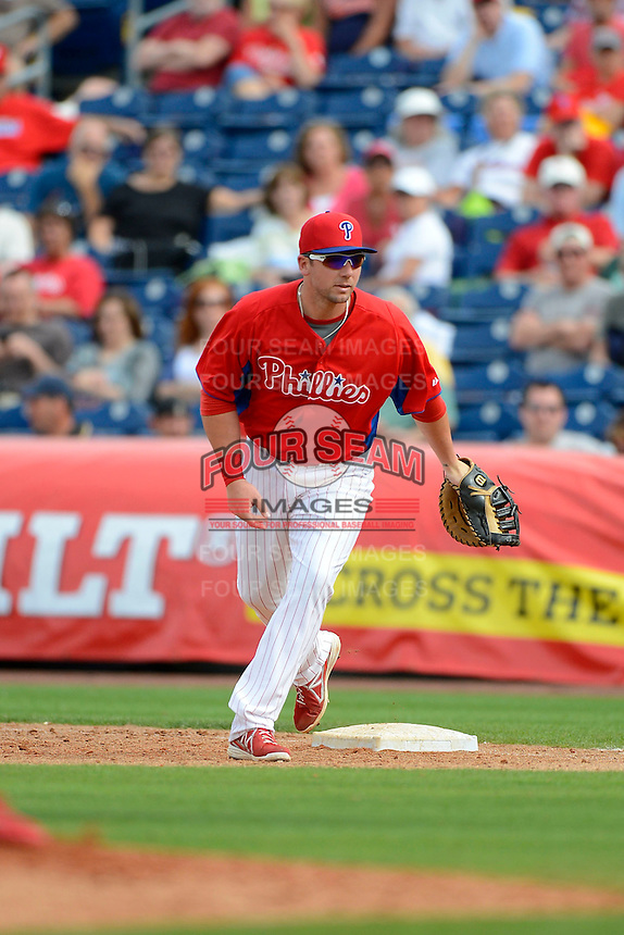 Philadelphia Phillies first baseman Josh Fields #24 during a Spring Training game against the New York Yankees at Bright House Field on February 26, 2013 in Clearwater, Florida.  Philadelphia defeated New York 4-3.  (Mike Janes/Four Seam Images)