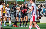 AMSTELVEEN -  Charlotte Vega (A'dam) heeft gescoord , met links Kelly Jonker (A'dam) en Marijn Veen (A'dam)   tijdens de hoofdklasse competitiewedstrijd hockey dames,  Amsterdam-Oranje Rood (5-2). COPYRIGHT KOEN SUYK