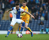 Blackburn Rovers' Derrick Williams shields the ball from Preston North End's Tom Barkhuizen<br /> <br /> Photographer Stephen White/CameraSport<br /> <br /> The EFL Sky Bet Championship - Blackburn Rovers v Preston North End - Saturday 18th March 2017 - Ewood Park - Blackburn<br /> <br /> World Copyright &copy; 2017 CameraSport. All rights reserved. 43 Linden Ave. Countesthorpe. Leicester. England. LE8 5PG - Tel: +44 (0) 116 277 4147 - admin@camerasport.com - www.camerasport.com