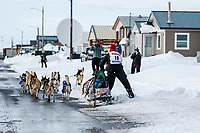 Aliy Zirkle runs down Front Street in Nome on her way to a 4th place finish during the 2019 Iditarod on Wednesday March 13<br /> <br /> Photo by Jeff Schultz/  (C) 2019  ALL RIGHTS RESERVED