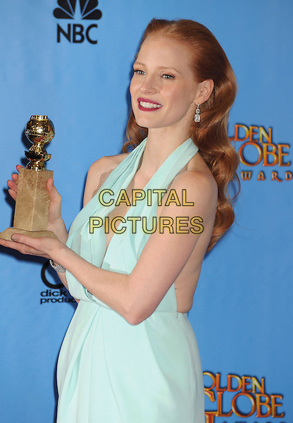 Jessica Chastain.Press Room at the 70th Annual Golden Globe Awards held at the Beverly Hilton Hotel, Beverly Hills, California, USA..January 13th, 2013.globes half length blue halterneck red lipstick plunging neckline award trophy winner .CAP/GAG.©GAG/Capital Pictures