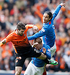 Bilel Mohsni jumps through Stevie Smith to win the ball fron Nadir Cifcti