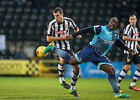 Adebayo Akinfenwa of Wycombe Wanderers & Haydn Hollis of Notts Co during the Sky Bet League 2 match between Notts County and Wycombe Wanderers at Meadow Lane, Nottingham, England on 10 December 2016. Photo by Andy Rowland.
