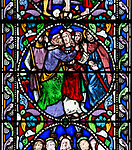 Stained glass window ofJ udas and Christ by William Wailes dated 1860, Bishops Cannings church, Wiltshire, England, UK