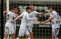 Pictured: Adam King of Swansea City (2nd L) celebrates his goal with team mates Monday 15 May 2017<br />