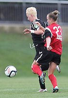 BOYDS, MARYLAND - July 21, 2012:  Joanna Lohman (17) of DC United Women is tackled from behind by Jamie Clark (23) of the Virginia Beach Piranhas during a W League Eastern Conference Championship semi final match at Maryland Soccerplex, in Boyds, Maryland on July 21. DC United Women won 3-0.