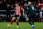 Billy Sharp (L) of Sheffield United runs at Jonjo Shelvey of Newcastle United during the Premier League match at Bramall Lane, Sheffield. Picture date: 5th December 2019. Picture credit should read: James Wilson/Sportimage