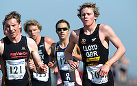 25 MAR 2012 - LOUGHBOROUGH, GBR - Liam Lloyd (Welsh Triathlon Talent Squad) (right) heads into transition at the end of the first run during the 2012 British Elite Duathlon Championships at Prestwold Hall Airfield in Prestwold near Loughborough, Great Britain (PHOTO (C) 2012 NIGEL FARROW)