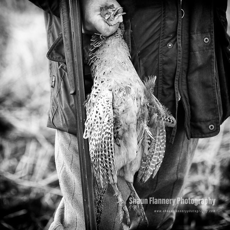 Pix: Shaun Flannery/sf-pictures.com..COPYRIGHT PICTURE>>SHAUN FLANNERY>01302-570814>>07778315553>>..19th December 2008...............Loversall 'game shoot' in Doncaster, South Yorkshire..A gun holds a dead Partridge after a drive.