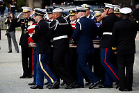 The flag-draped casket of former President George H.W. Bush is carried by a joint services military honor guard after a State Funeral at the National Cathedral, Wednesday, Dec. 5, 2018, in Washington. <br /> CAP/MPI/RS<br /> &copy;RS/MPI/Capital Pictures