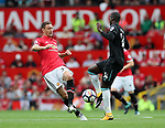 Manchester United's Nemanja Matic tussles with West Ham's Pedro Obiang during the premier league match at Old Trafford Stadium, Manchester. Picture date 13th August 2017. Picture credit should read: David Klein/Sportimage