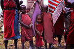Africa, Kenya, Maasai Mara. Maasai children standing with their mothers at Olanana in the Maasai Mara.