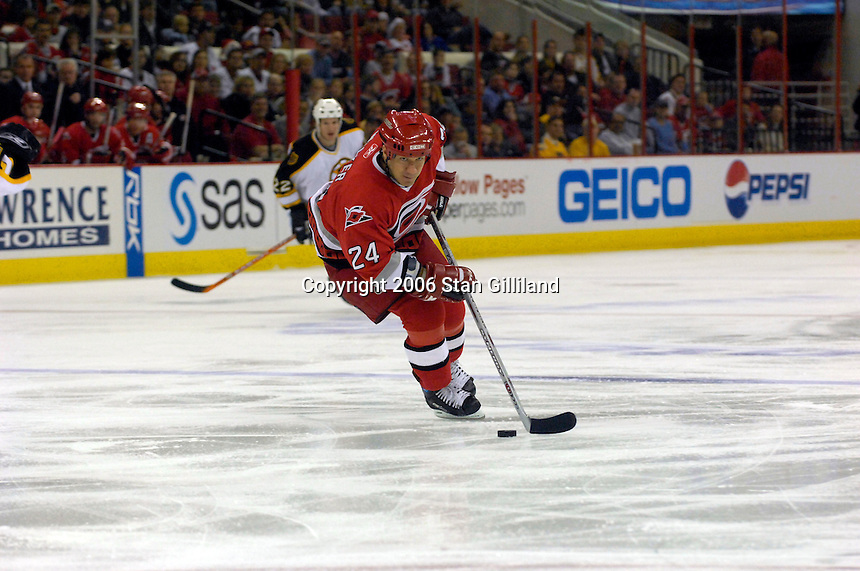 The Carolina Hurricanes' Scott Walker turns toward the goal during an NHL hockey game against the Boston Bruins Saturday, Dec. 2, 2006 in Raleigh, N.C. Carolina won 5-2.<br />