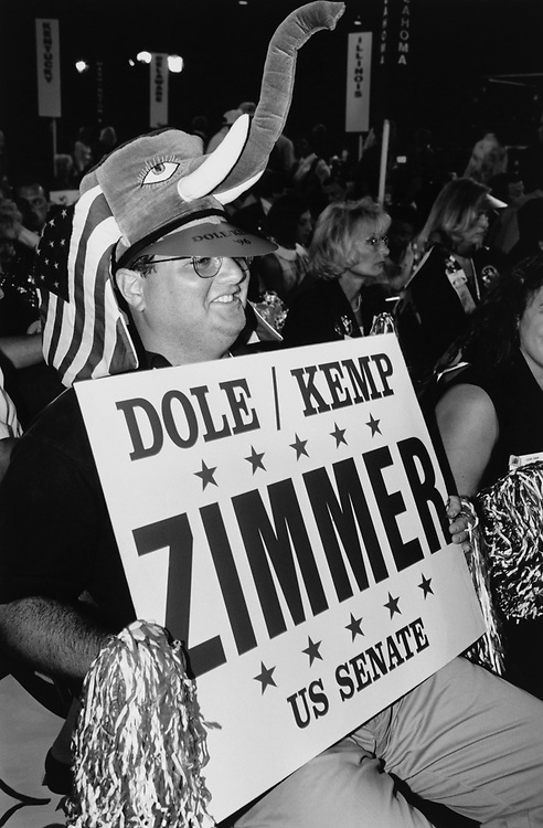 Supporting member holding the placard for US Senator at Republican National Committee, in 1996. (Photo by Laura Patterson/CQ Roll Call via Getty Images)