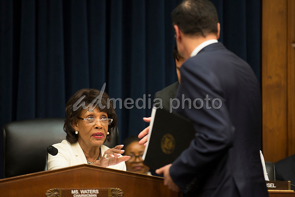 Chair of the United States House Financial Services Committee Maxine Waters (Democrat of California) speaks with US Secretary of the Treasury Steven T. Mnuchin prior to his giving testimony regarding the US House Democrats' request to release President Trump's tax returns on Capitol Hill in Washington, DC on April 9, 2019.<br /> Credit: Stefani Reynolds / CNP/AdMedia