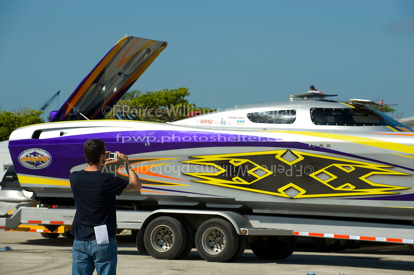 "19-22 June, 2008 OSS Sunny Isles Beach.A spectator takes a photo of the 47' Outerlimits ""xXx"" in the dry pits..©2008 F.Peirce Williams  ."