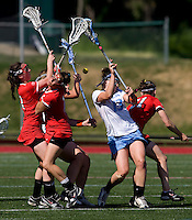 Becky Lynch (13) of North Carolina fights for the ball with Cornell's Kate Ivory (7), Jessi Steinberg (1) and Kaitlyn Giles (31) during their game at St. Stephens and St. Agnes High School in Alexandria, VA.  North Carolina defeated Cornell, 13-7.
