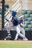 Carlos Herrera (2) of the Asheville Tourists follows through on his swing against the Kannapolis Intimidators at Kannapolis Intimidators Stadium on May 7, 2017 in Kannapolis, North Carolina.  The Tourists defeated the Intimidators 4-1.  (Brian Westerholt/Four Seam Images)