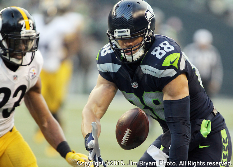 Seattle Seahawks tight end Jimmy Graham catches a pass while being defended by Pittsburgh Steelers safety Mike Mitchell (23) at CenturyLink Field in Seattle, Washington on November 29, 2015.  The Seahawks beat the Steelers 39-30.      ©2015. Jim Bryant Photo. All Rights Reserved.