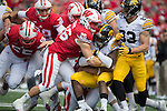 Wisconsin Badgers Derek Straus (26) and the kickoff unit make a gang tackle during an NCAA Big Ten Conference college football game against the Iowa Hawkeyes Saturday, October 3, 2015. The Hawkeyes won 10-6. (Photo by David Stluka)