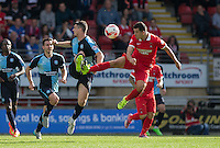 Lloyd James of Leyton Orient & Stephen McGinn of Wycombe Wanderers go in for the ball during the Sky Bet League 2 match between Leyton Orient and Wycombe Wanderers at the Matchroom Stadium, London, England on 19 September 2015. Photo by Andy Rowland.