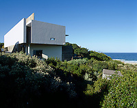 As all the windows in this house are south facing and oriented towards the beach the north facing rear of the house is windowless
