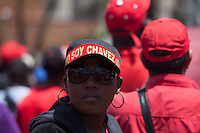CARACAS - VENEZUELA 08-03-2013, Una mujer viste una gorra de Chávez durante el funeral de estado. El lider y  presidente de Venezuela, Hugo Chávez Frías, falleció el pasado martes 5 de marzo de 2013 a causa de un cancer a la edad de 58 años./ A girl wears a Chavez cap during the state funeral. The leader and president of Venezuela, Hugo Chavez Frias who died by cancer the past March 5th of 2013 at the age of 58. Photo: VizzorImage / CONT
