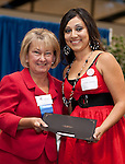 Nancy Blackwell, Principal of MacArthur Senior High School holds Scholarship award with winner, Selena Adame at the 2011 Aldine Scholarship Foundation Scholarship Ceremony at Lone Star College - North Harris.
