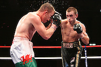 John Murray (black shorts) defeats Gary Buckland in a Lightweight Boxing contest for the European EBU Title and the British Title at the Kingsway Leisure Centre, Widnes, promoted by Matchroom Sports - 07/05/10 - MANDATORY CREDIT: Chris Royle