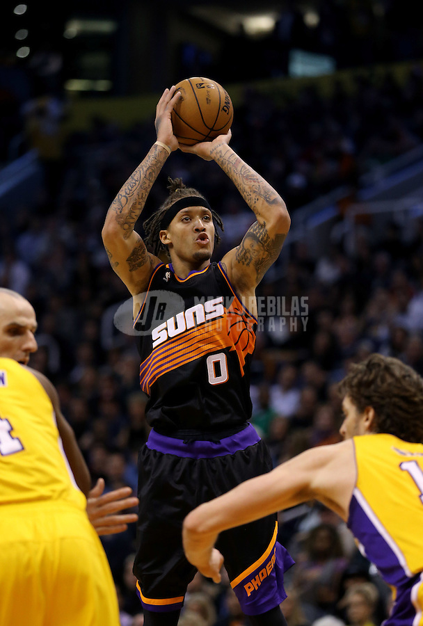 Jan. 30, 2013; Phoenix, AZ, USA: Phoenix Suns forward Michael Beasley (0) takes a shot in the second half against the Los Angeles Lakers at the US Airways Center. The Suns defeated the Lakers 92-86. Mandatory Credit: Mark J. Rebilas-