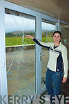 Norma Foley pictured here showing some of the damage caused by vandals to the Waterville Lake Hotel.