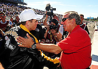 Nov 14, 2010; Pomona, CA, USA; NHRA top fuel dragster driver Larry Dixon (left) is congratulated by Don Schumacher after winning the 2010 top fuel championship during the Auto Club Finals at Auto Club Raceway at Pomona. Mandatory Credit: Mark J. Rebilas-