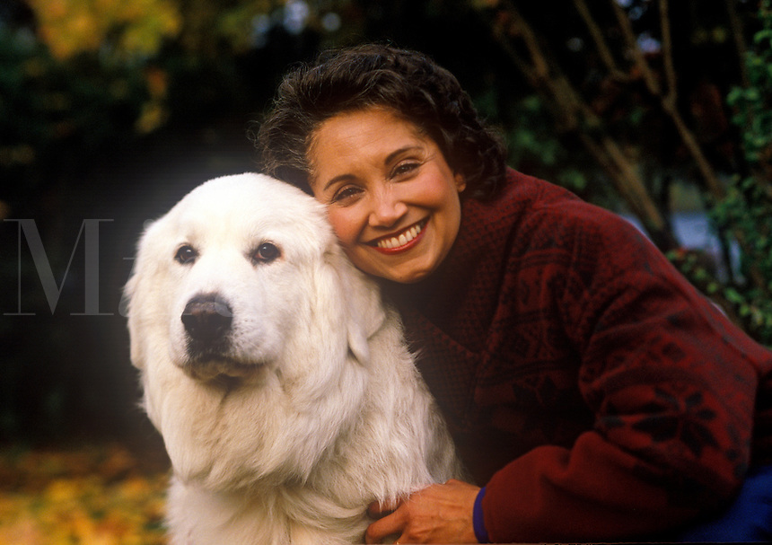Portrait of a smiling woman with her pet dog.