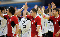 11 JUN 2010 - LONDON, GBR - British (in red) and Estonian (in white and black) players acknowledge each other after their 2012 European Handball Championships Qualification Tournament match .(PHOTO (C) NIGEL FARROW)